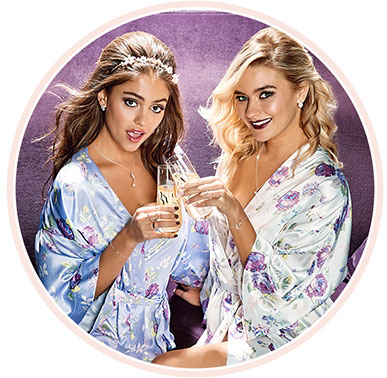 bride and bridesmaid in floral robes
